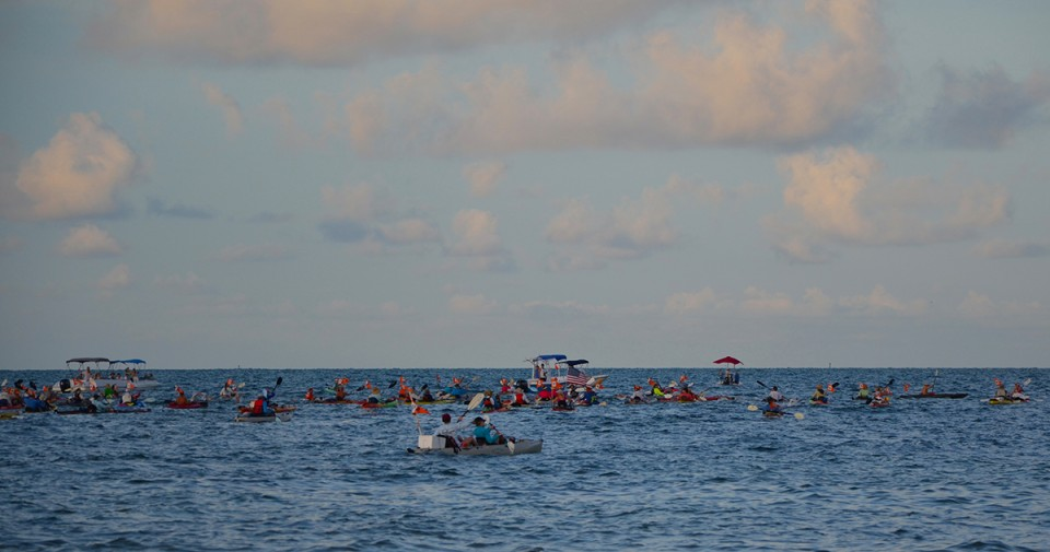 The kayakers: every swimmer must have a support vessel with them throughout the swim.  This is at the beginning of the race.